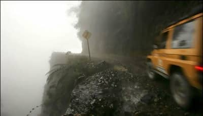Macintosh HD:Users:brittanyloeffler:Downloads:Upwork:Dangerous Roads:1-Bolivia's+Road+of+Death.jpg