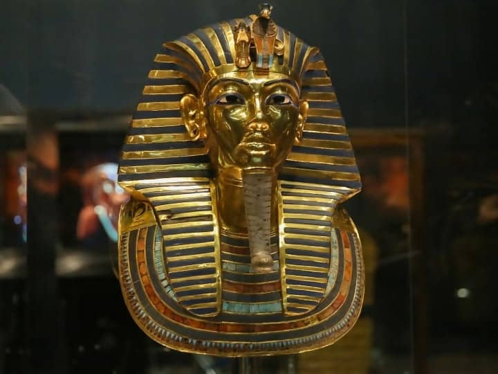 CAIRO, EGYPT - DECEMBER 16: The golden funerary mask of Tutankhamun, a king of Ancient Egypt is being displayed during an unveiling ceremony at the Egyptian Museum after its restoration process completed by German restoration specialist Christian Eckmann and his team, on December 16, 2015 in Cairo, Egypt.