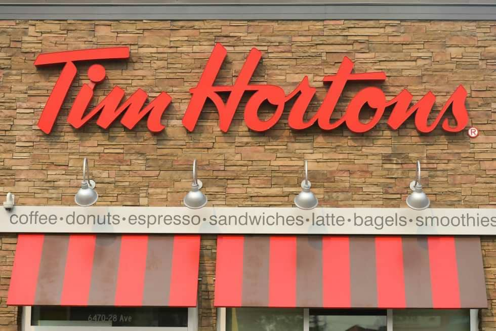 Macintosh HD:Users:brittanyloeffler:Downloads:Upwork:Fast Food:view-of-tim-hortons-logo-in-riverbend-area-of-edmonton-on-news-photo-1032912226-1545341003.jpg