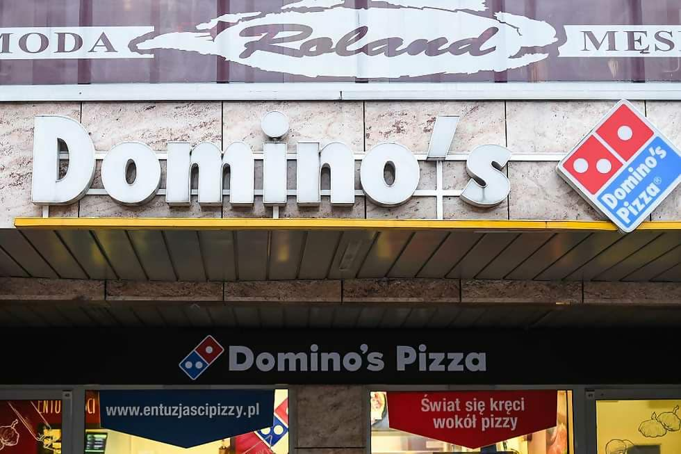 Macintosh HD:Users:brittanyloeffler:Downloads:Upwork:Fast Food:dominos-pizza-restaurant-logo-on-the-building-located-in-news-photo-626985174-1545339269.jpg