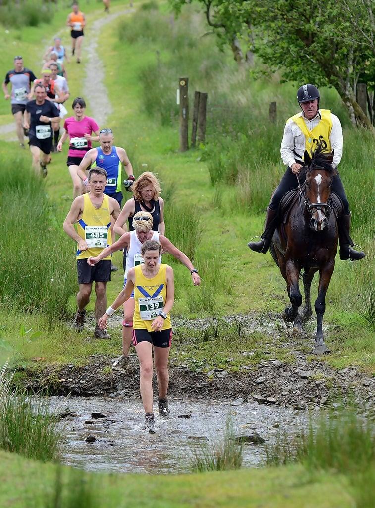 Macintosh HD:Users:brittanyloeffler:Downloads:Upwork:Strange Sports:Man-Versus-Horse-Marathon.jpg