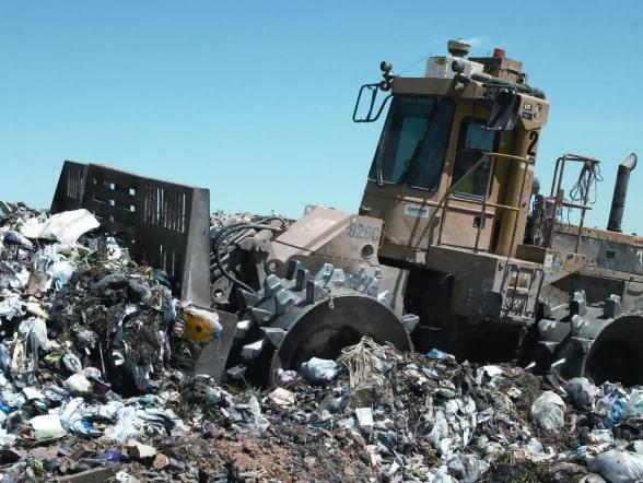 Trash compactor, landfill, lost bitcoin