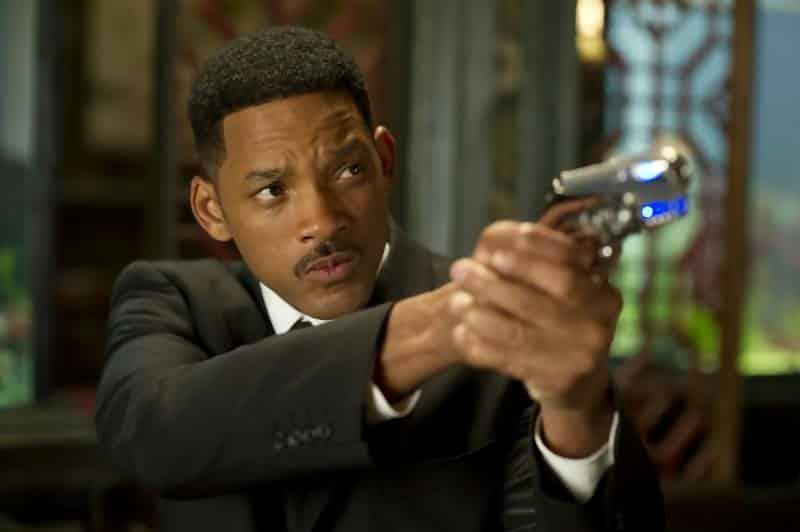 Will Smith points a blaster in Men in Black 3